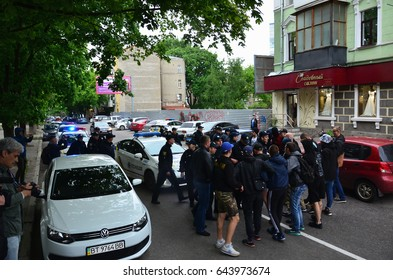 KHARKOV, UKRAINE - MAY 17, 2017: Blocking of exit to police cars by Kharkiv right-wing activists during the breakdown of the LGBT rally in Kharkov
