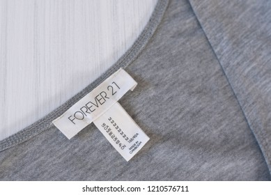 KHARKOV, UKRAINE- OCTOBER 1, 2018: White tag FOREVER 21 on gray clothes. Close up