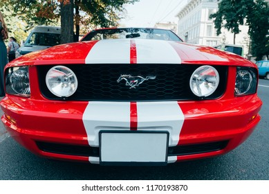 KHARKOV, UKRAINE - SEPTEMBER 1, 2018: Ford mustang red sport car outdoor exterior front view, wide angle.