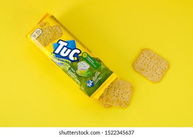 KHARKOV, UKRAINE - SEPTEMBER 23, 2019: Tuc snack pack on bright yellow flat background. TUC is a brand of snack biscuit marketed by Mondelez International