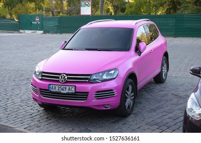 KHARKOV, UKRAINE - SEPTEMBER 24, 2019: Volkswagen Touareg Hybrid NF in magenta purple color on parking place