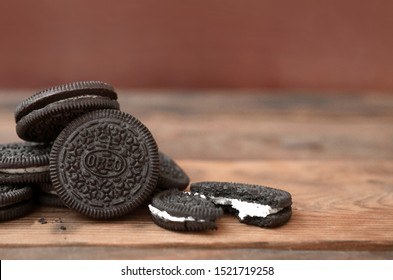 KHARKOV, UKRAINE - SEPTEMBER 8, 2019: Many OREO sandwich cream biscuits on wooden background. Oreo is a sandwich cookie with a sweet cream is the best selling cookie in the US