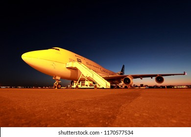 Khartoum, Sudan - March 20th 2018: Saudi Arabian Boeing 747-400 Jumbo Jet Freighter being unloaded and loaded