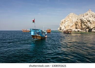 Khasab, Oman - Feb 9, 2019: Tourist dhow boat near Oman fjords, Musandam peninsula.