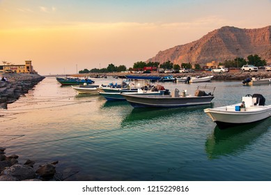 Khasab, Oman - October 5, 2018: Khasab city creek and desert rock scenery with characteristic Arabian houses at sunset