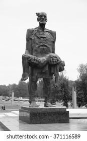 "KHATYN, BELARUS - JUNE 19, 2014: Memorial complex in Khatyn. Sculpture of the ""Unbowed man"" at the Khatyn Memorial site."