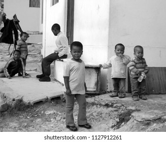 KHAYELITSHA, CAPE TOWN SOUTH AFRICA MAY 22 2007: A unidentified group of young children play on a street of Khayelitsha township in Western Cape reputed to be the largest and fastest growing in SA.