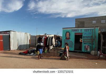 Khayelitsha, Western Cape, South Africa - June 19, 2018:   A view of the market place serving the residents of Khayelitsha with locals going about their daily chores.