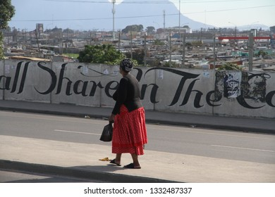 Khayelitsha, Western Cape, South Africa - June 19, 2018:  The huge bridge crossing highway N2 into the informal township of Khayelitsha on the Cape Flats of Cape Town, South Africa.