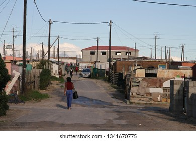 Khayelitsha, Western Cape, South Africa - June 19, 2018: A streetscape view of the dusty road of the village of Khayelitsha, Western Cape, South Africa.