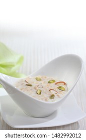 Kheer or Firni is a rice pudding, originating from the Indian subcontinent, made by boiling milk and sugar with one of the following: rice, broken wheat, tapioca, vermicelli, sweet corn, etc.