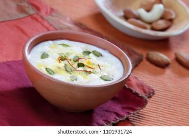 Kheer (Indian sweet dish) in a earthen bowl.