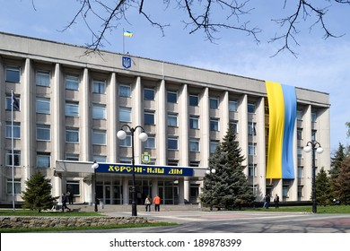 KHERSON, UKRAINE - APRIL 15, 2014: large Ukrainian flag on the city hall of Kherson in the Southern part of Ukraine for integrity of Ukraine against Russian aggressive  attempts to split the country.
