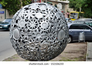 KHERSON, UKRAINE - AUG 27: close view of advertising ball made of hubcaps near tire repair shop of official Hyundai and KIA service station taken on August 27, 2013 in Kherson, Ukraine.