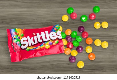 KHERSON, UKRAINE - AUGUST 30, 2018: KHERSON, UKRAINE - NOVEMBER 05, 2014:  Closeup of Skittles candies made by Wm. Wrigley Jr. Company isolated on white background