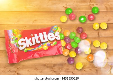 KHERSON, UKRAINE - JULY 13, 2019: KHERSON, UKRAINE - NOVEMBER 05, 2014:  Closeup of Skittles candies made by Wm. Wrigley Jr. Company isolated on white background