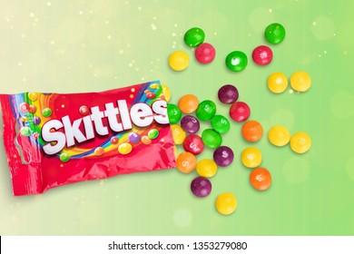KHERSON, UKRAINE - MARCH 28, 2019: KHERSON, UKRAINE - NOVEMBER 05, 2014:  Closeup of Skittles candies made by Wm. Wrigley Jr. Company isolated on white background