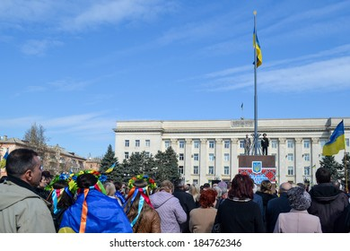 KHERSON, UKRAINE - MARCH 30, 2014: demonstrators for integrity of Ukraine against Russian intervention and unveiling of a memorial to recently fallen for democracy heroes instead of deposed Lenin.