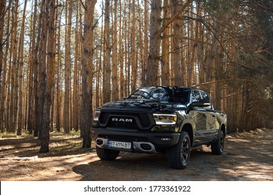 Kherson. Ukraine - May 2019: powerful American SUV Dodge Ram on a spring forest background.