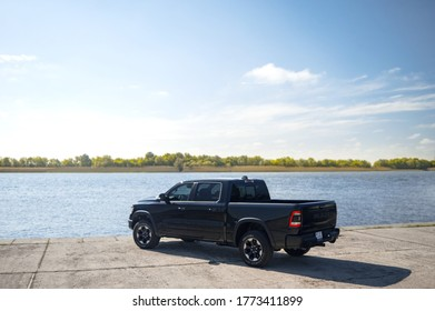 Kherson, Ukraine - May 2019: powerful American pickup Dodge Ram on the background of the Dnieper River.