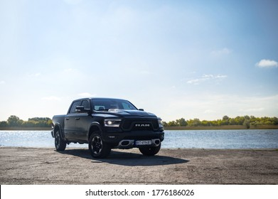 Kherson. Ukraine - May 2019: powerful American SUV Dodge Ram against the backdrop of the Dnieper River.