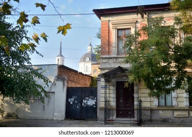 KHERSON, UKRAINE - OCTOBER 21, 2018: A view of typical Kherson outlying old streets with their uncomplicated architecture and calm and peaceful air. Kherson is a regional town on South of Ukraine.