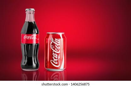 KHERSON, UKRAINE - OCTOBER 23, 2018: rare red coca-cola contour bottle on red background