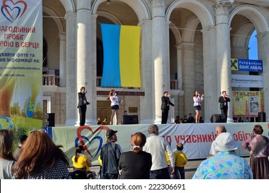 """KHERSON, UKRAINE - SEPTEMBER 21, 2014: a local popular Ukrainian police band """"General Voice"""" sing on Day of Town foundation special festivity in favor of cerebral palsy handicapped persons."""