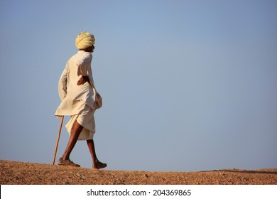 KHICHAN, INDIA - FEBRUARY 12: An unidentified man walks on a hill on February 12, 2011 in Khichan, India.