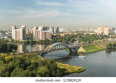 KHIMKI, MOSCOW REGION, RUSSIA - 30 august 2018: The ship passes through the Moscow canal under the Khimki railway bridge