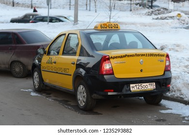 KHIMKI, RUSSIA - FEBRUARY 20, 2013: Renault Logan Taxi car on the street in black and yellow colours