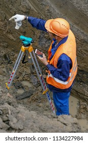 Khimki, Russia - July 12, 2018: The surveyor performs geodetic survey for the cadastre