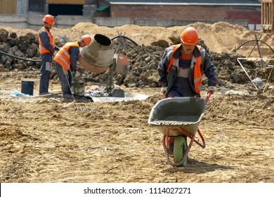 Khimki, Russia - June 13, 2018: Construction worker wheelbarrow
