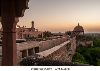 KHIMSAR, RAJASTHAN, INDIA - OCT 15, 2011 : the rosy light of dawn light up the fortifications and walls of the Khimsar Fort, now transformed into a luxury hotel, October 15, 2011