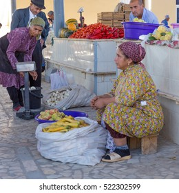 KHIVA, UZBEKISTAN - AUGUST 25, 2016: unidentified people make food shopping at the fruit and vegetable market close the East Gate of Khiva, in Uzbekistan.