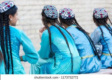 KHIVA, UZBEKISTAN - AUGUST 27, 2018: Folk dancers performs traditional dance at local festivals in Khiva, Uzbeksitan.