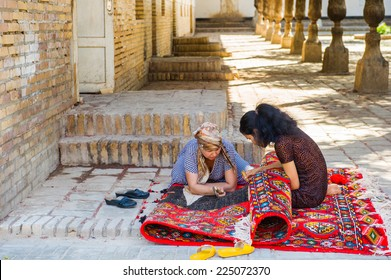 KHIVA, UZBEKISTAN - JUNE 4, 2011: Two unidentified Uzbek women are working on a carpet in Uzbekistan, Jun 4, 2011.  81% of people in Uzbekistan belong to Uzbek ethnic group