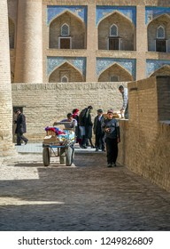 KHIVA, UZBEKISTAN - MARCH 20: Unidentified people visit fortress of Khiva on March 20, 2012 in Khiva. The town is part of UNESCO World Heritage.