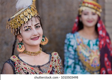 KHIVA, UZBEKISTAN - MAY 24, 2017: Uzbek women in traditional costumes, in Khiva, Uzbekistan.