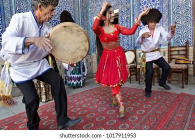 KHIVA, UZBEKISTAN - MAY 24, 2017: Khorezmian musicians in local dress dance, in Khiva, Uzbekistan.