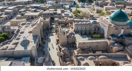KHIVA, UZBEKISTAN - MAY 3, 2019: Historic architecture of Itchan Kala, walled inner town of the city of Khiva, Uzbekistan. UNESCO World Heritage Site.