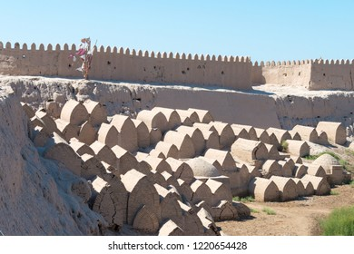 Khiva, Uzbekistan - Sep 05 2018: The old cemetery at Ancient city of Itchan Kala in Khiva, Uzbekistan. Itchan Kala is Unesco World Heritage Site.