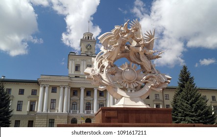 "Khmelnytskyi, Ukraine - May 12, 2018: The Khmelnitsky region goverment building on the Indepence square with sculpture ""Faith Hope Love"" before it."