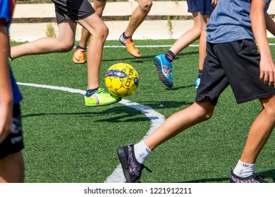Khmelnytskyi. Ukraine. November 2018. Children play soccer on a stadium with artificial cover