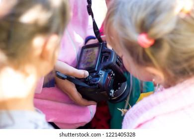 Khmelnytskyi. Ukraine. October 2018. Girls are looking at photos captured on the camera