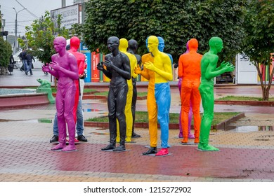 Khmelnytskyi. Ukraine. October 2018. Sculptures by V. Sidorenko. Multicolored sculptures of people. The dialogue of representatives of different races.