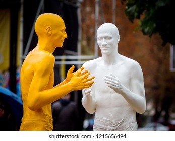 Khmelnytskyi. Ukraine. October 2018. Sculptures by V. Sidorenko.  People with white and yellow skin color. Dialogue of representatives of different races.