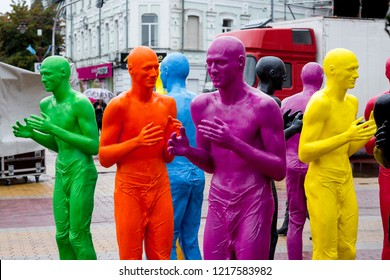 Khmelnytskyi. Ukraine. October 2018. Sculptures by V. Sidorenko. Multicolored sculptures of people. Dialogue of representatives of different races. Understanding between people with different skin