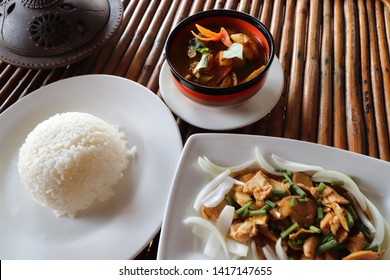 Khmer lunch of amok trey or fish steamed in curry and ginger chicken( sach moan char knhey) with rice