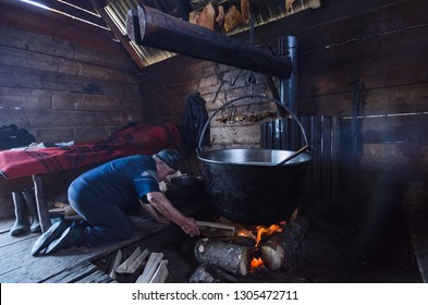 KHOMYAK,CARPATHIAN MOUNTAINS/UKRAINE July, 12, 2016: Cheese maker cook in the mountains produces cheese according to an traditional, old recipe cooks it in a cauldron on a campfire